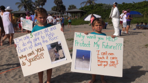 RiverKidz protesting discharges from Lake Okeechobee into the St. Lucie River at Stuart Beach on August 11, 2013
